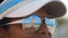 woman-looking-at-another-womand-dancing-on-beach-through-her-sunglasses_nklfdas8__F0000.png